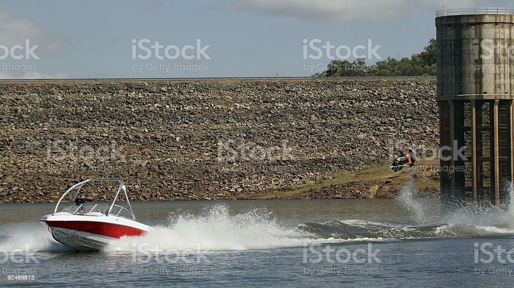 Wakeboarder flies, long wide shot stock photo