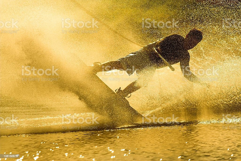 Wakeboarder on Lake at Sunset stock photo
