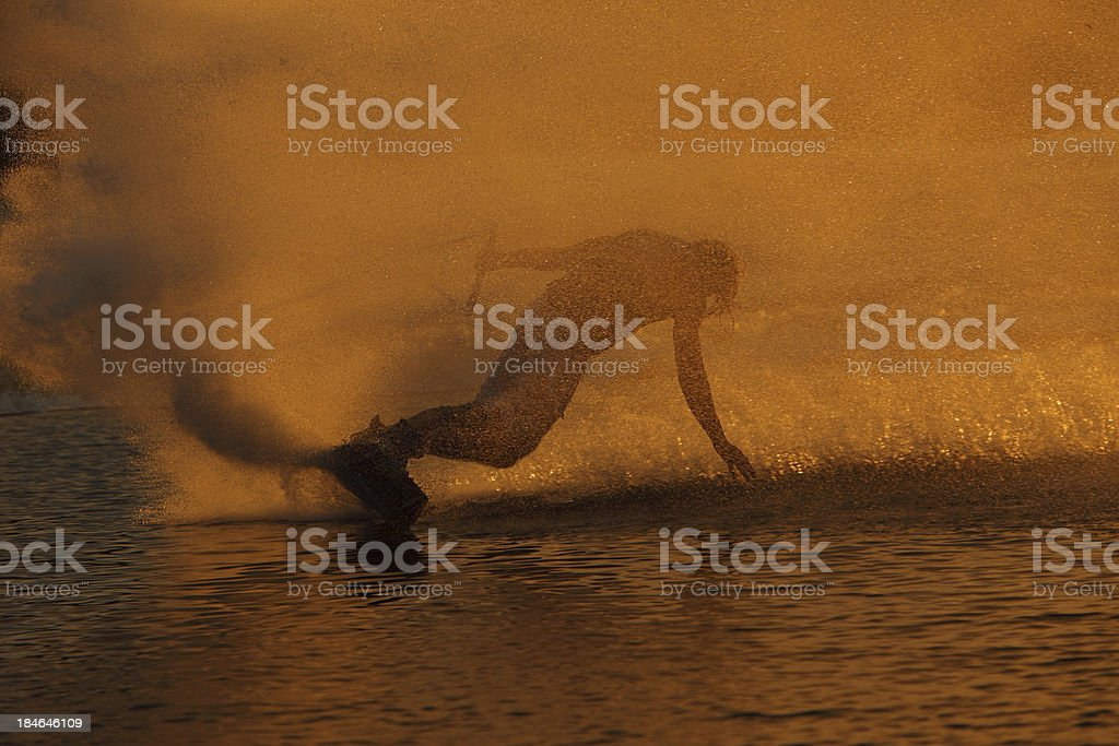 Wakeboarder slides as silhouette. royalty-free stock photo