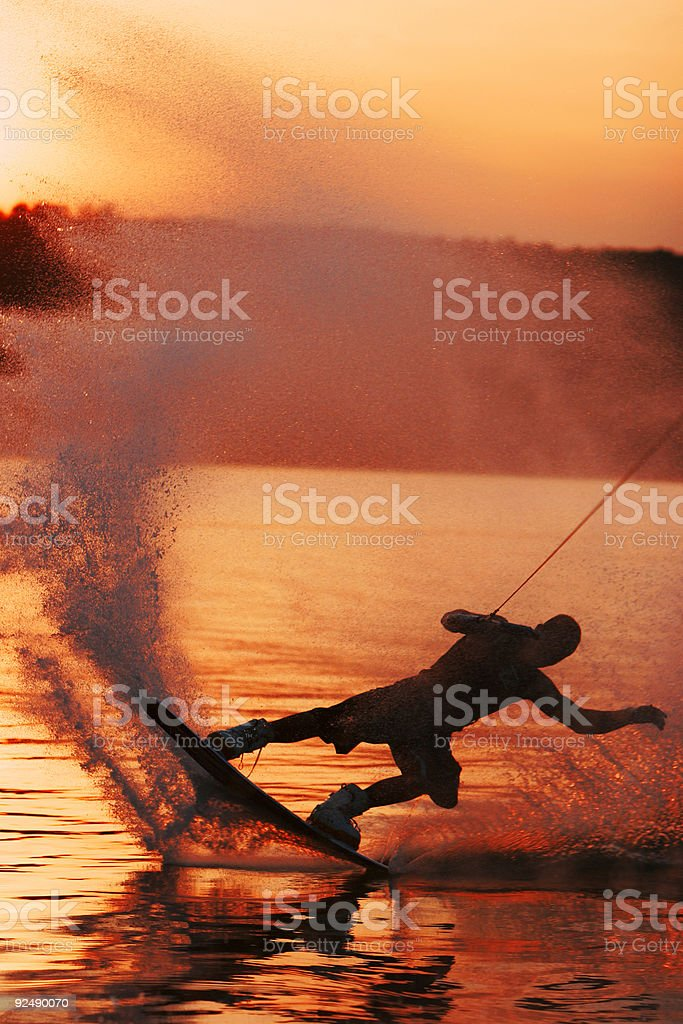 Wakeboarder sliding sunset royalty-free stock photo