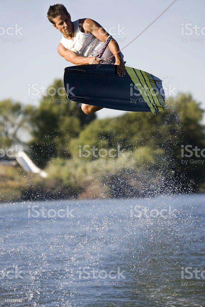 Wakeboarder-Huge Air Heel Side Grab stock photo