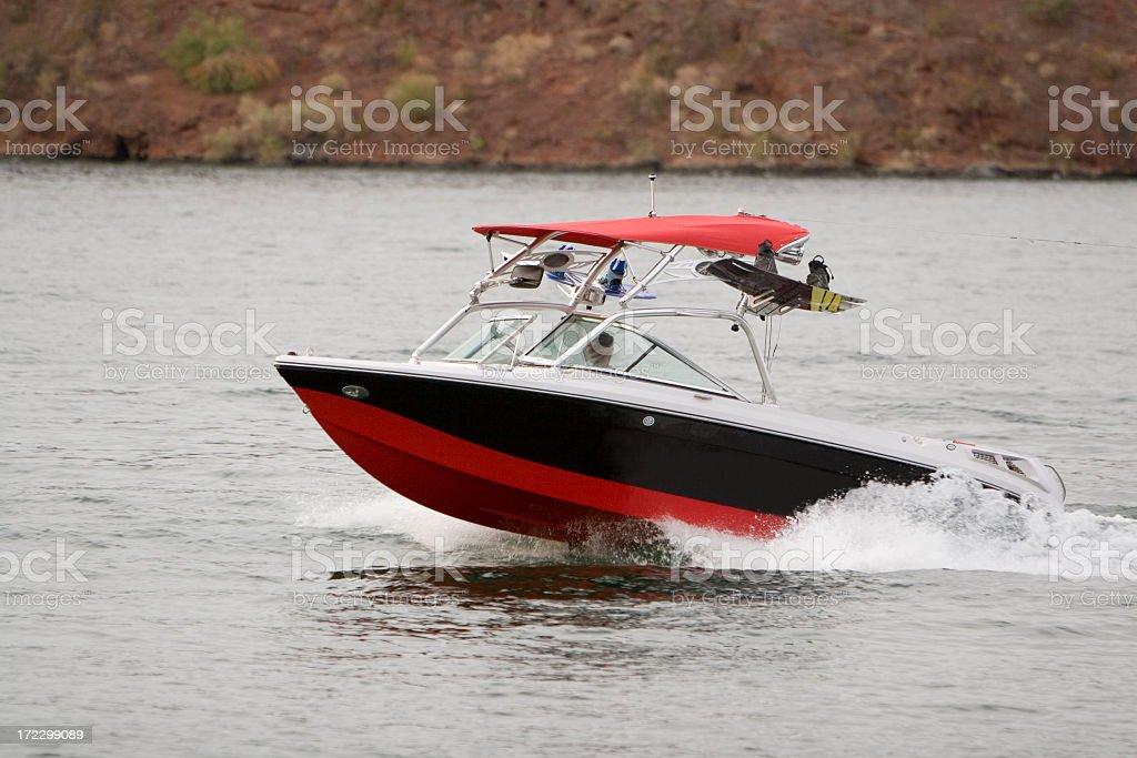 wakeboarding boat stock photo