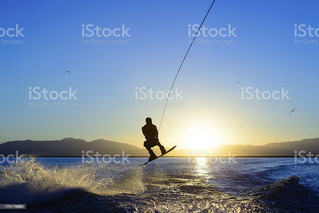 Wakeboarding Jump at Sunset stock photo