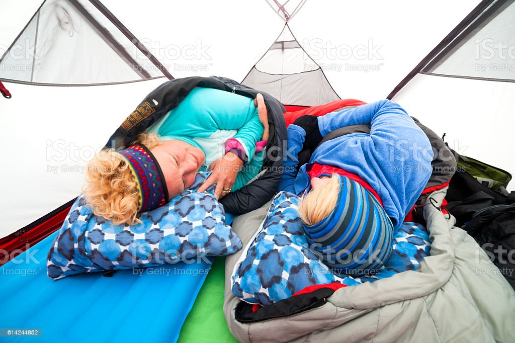 Waking up cold in a tent stock photo