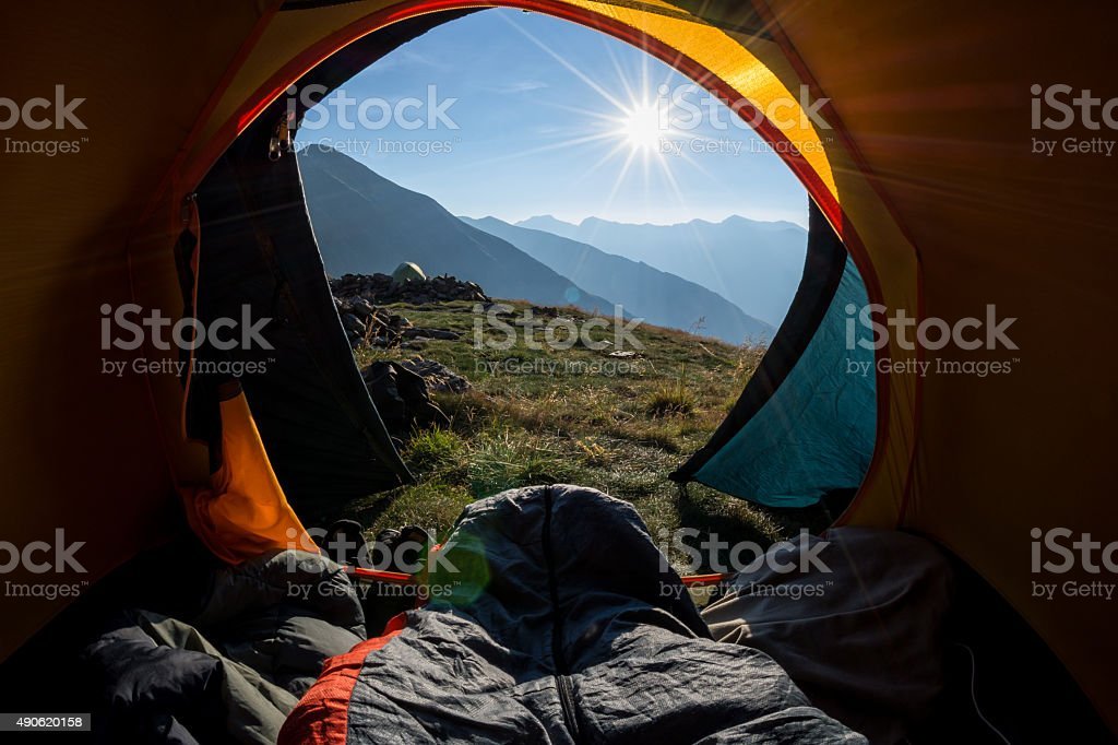 Waking up in the tent stock photo