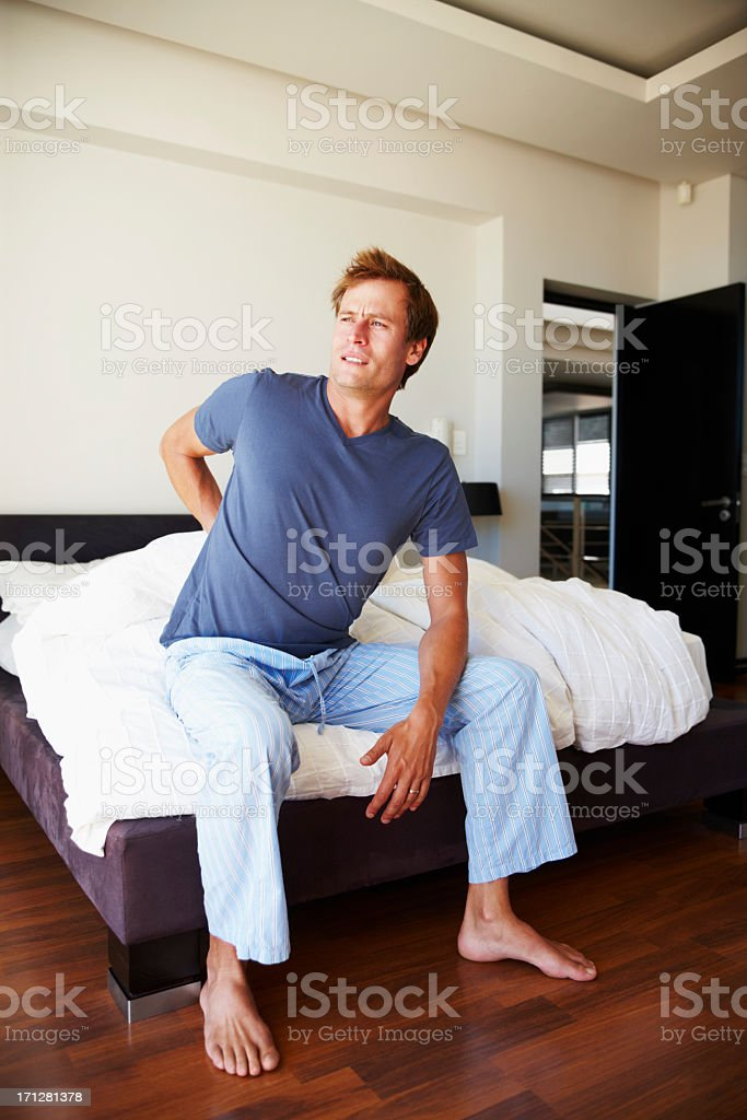 Waking up with back pain royalty-free stock photo