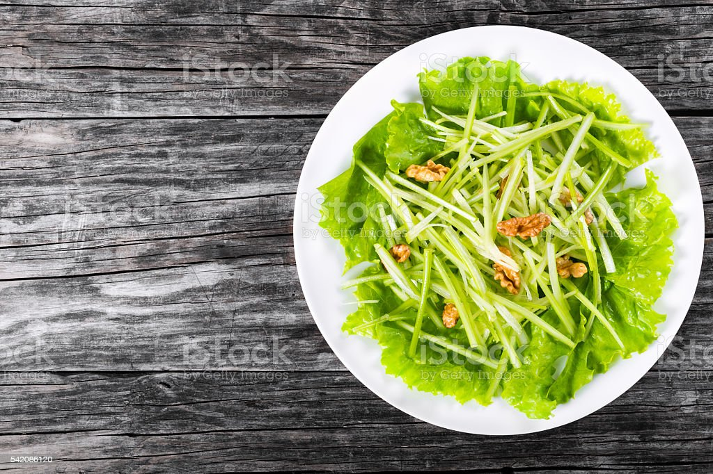 Waldorf Salad with green apples, celery and walnuts, top view stock photo