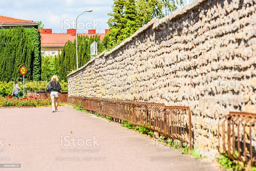 Walk along the wall stock photo