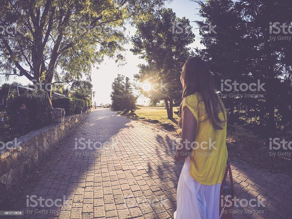 Walk in sunset stock photo