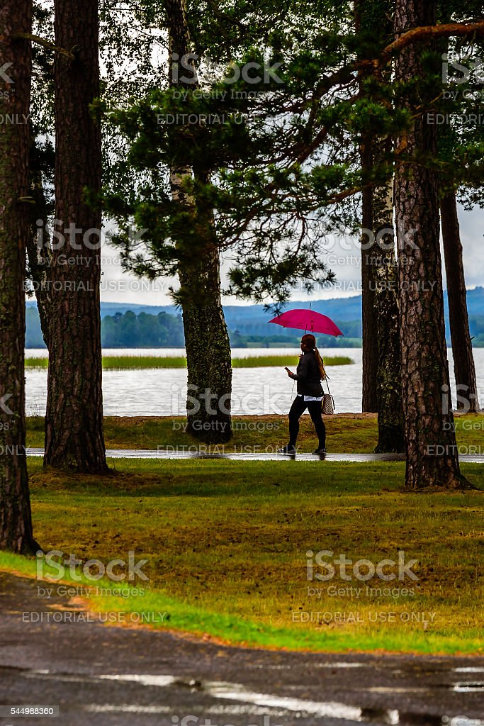 Walk in the rain stock photo