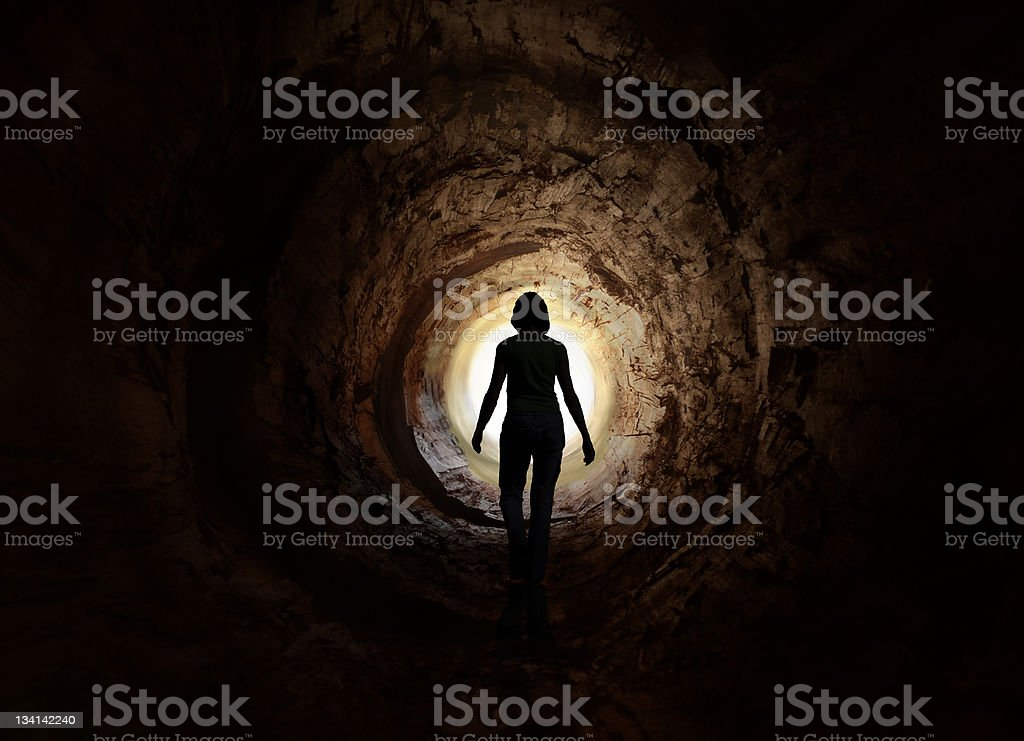 Walk into the light. Escape, exit, death stock photo