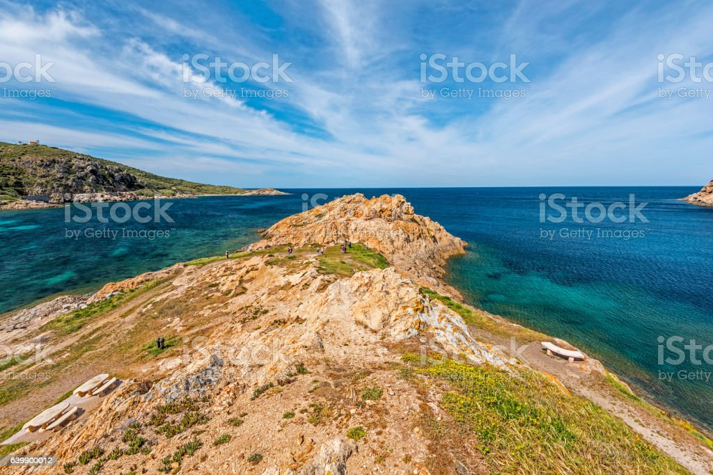 Walk pass along Red Porphyry rocks of Pietra Islet stock photo