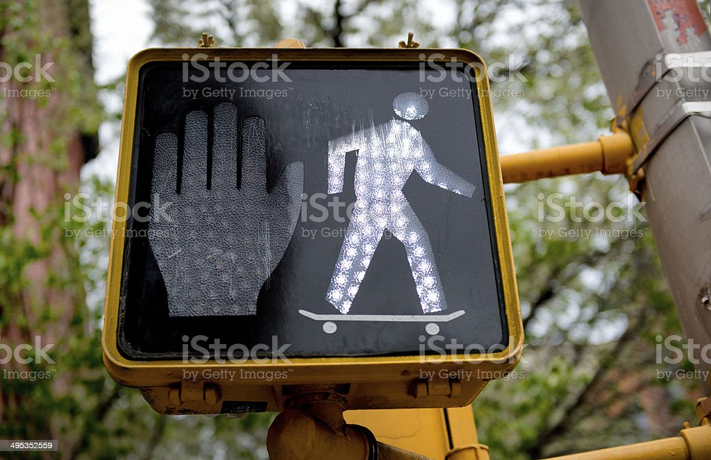 Walk sign with skateboarder stock photo