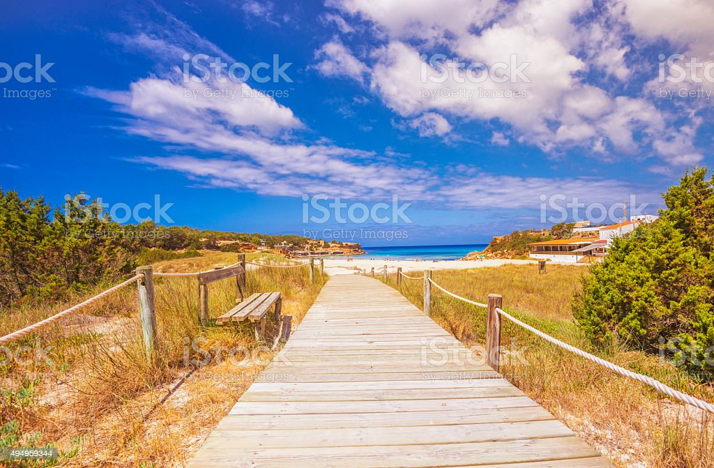 Walk through sand dunes to Cala Saona on Formentera stock photo