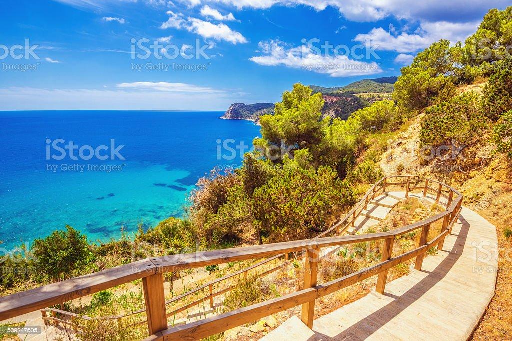 Walk to Cala Es Cubells in Ibiza stock photo