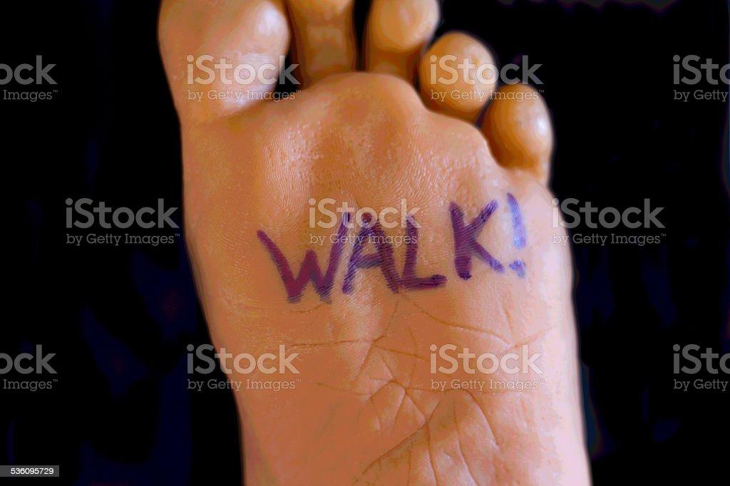 'Walk!' Written on Bottom of Foot stock photo