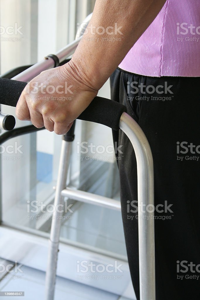 Walker for an injured person with a hand royalty-free stock photo