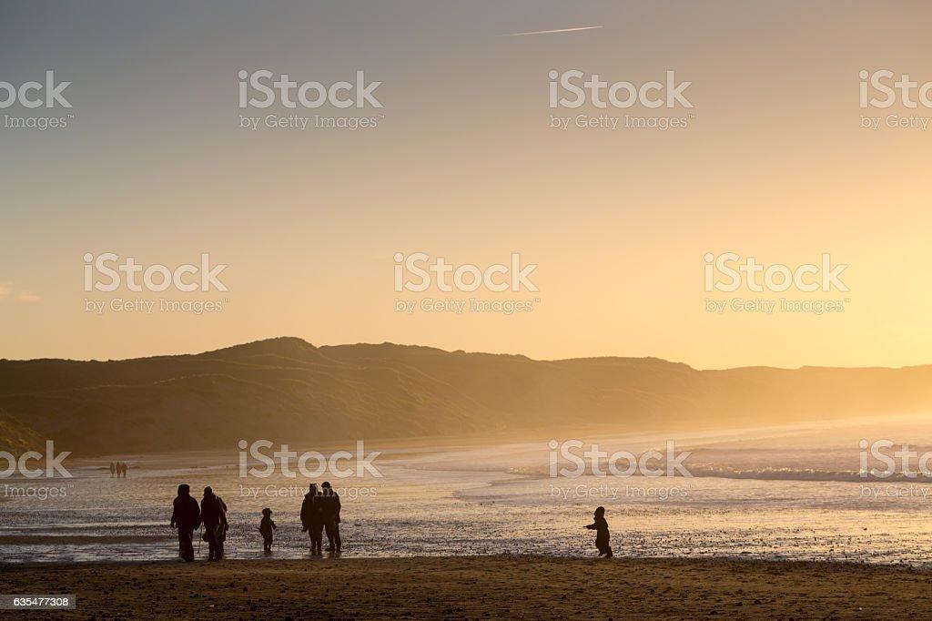 Walker on Dunnet beach stock photo