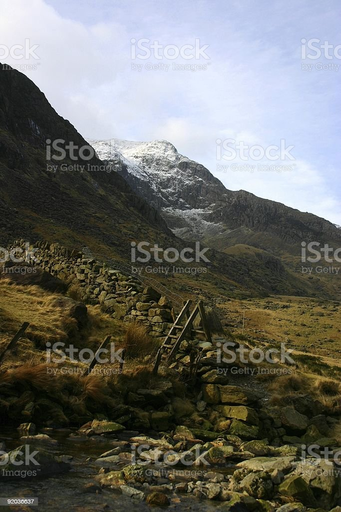 walker's ladder -- gold autumnal hue around rocky Snowdon stock photo