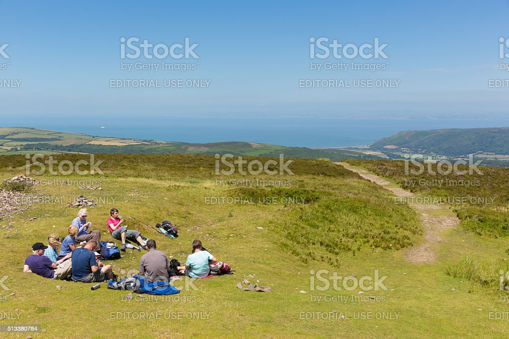 Walkers resting Dunkery Hill Exmoor near Minehead Somerset UK stock photo
