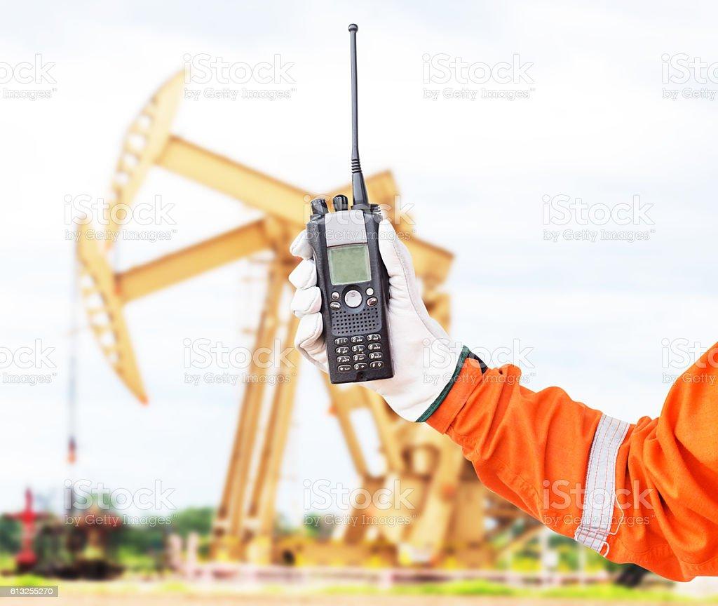 walkie-talkie radio in hand stock photo