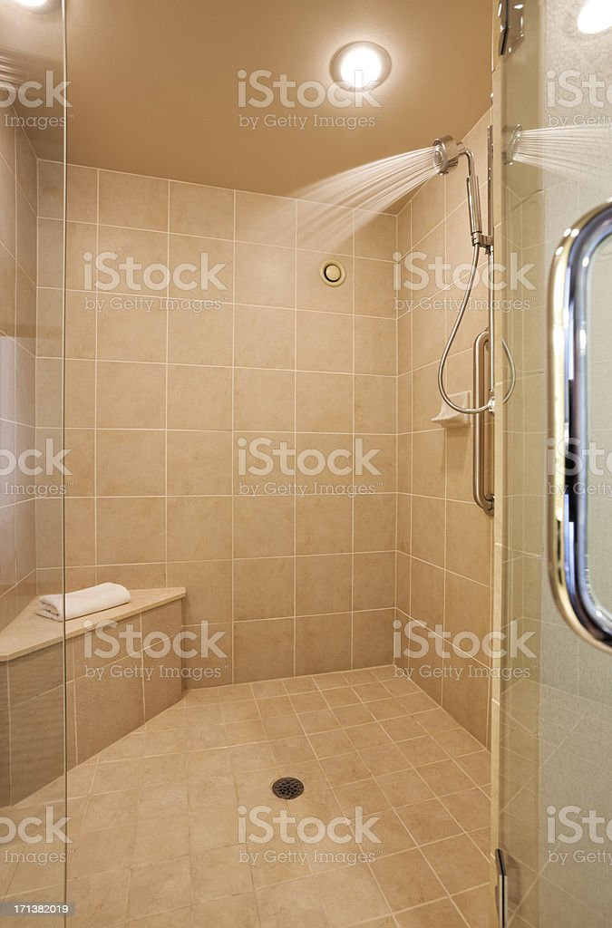 Walk-in shower with tile and glass door. royalty-free stock photo