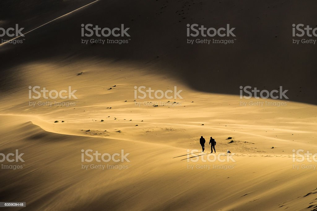 Walking a sand dune stock photo