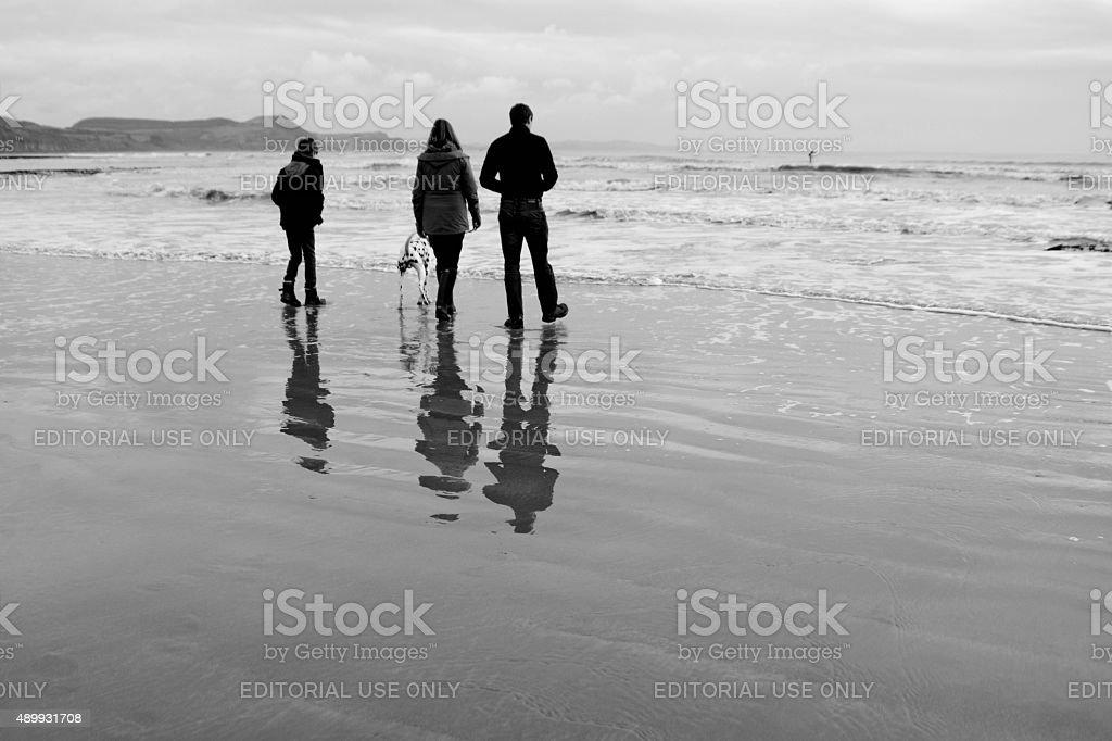 Walking along a pebble beach stock photo