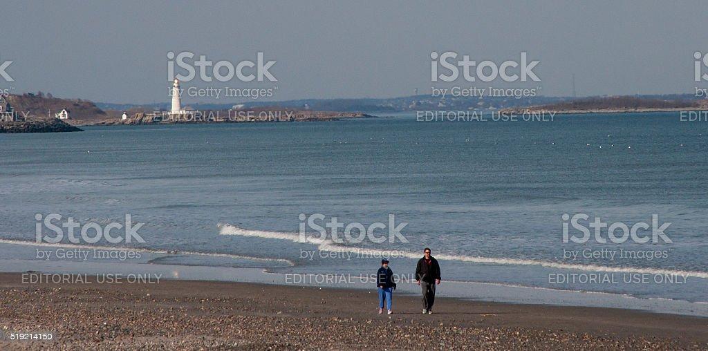 Walking Along Nantasket Beach In Winter stock photo
