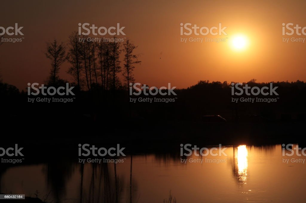 Walking along the shore of a large lake. stock photo