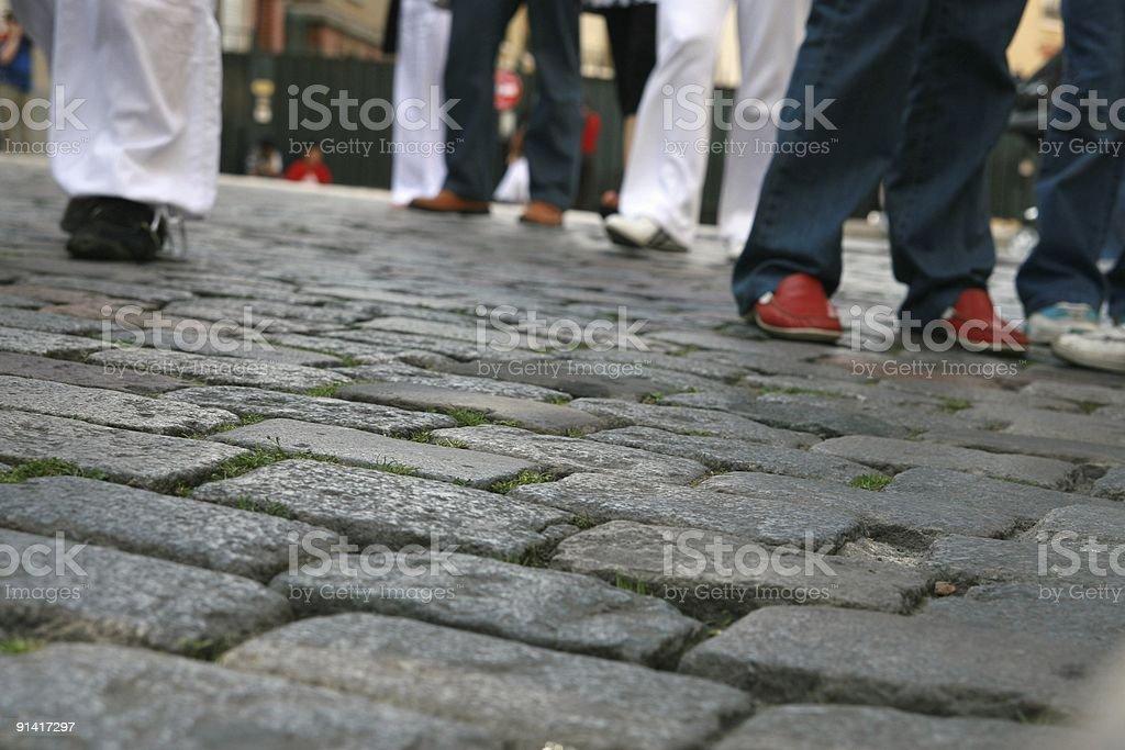 Walking along the street. Caminando stock photo