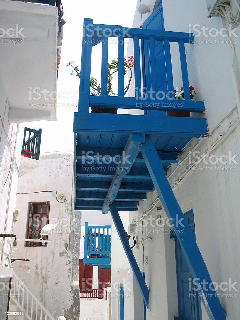 Walking an alley in Myconos stock photo