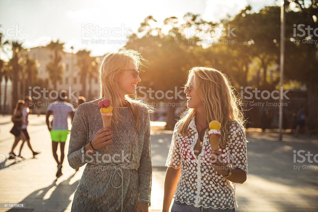 Walking and eating ice cream stock photo
