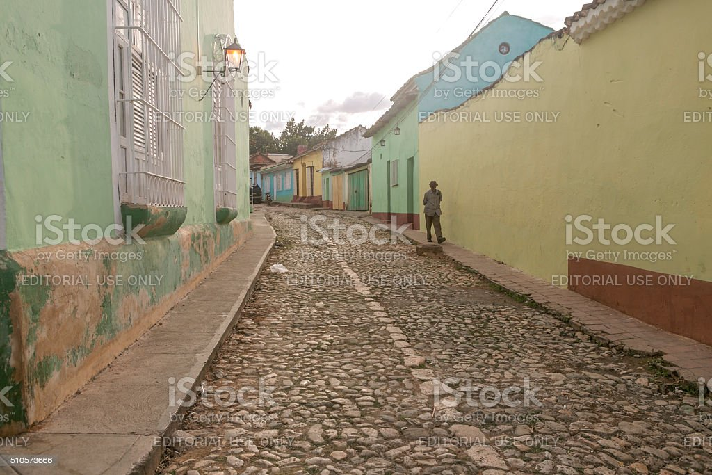 walking at front of traditional houses  in trinidad cuba stock photo