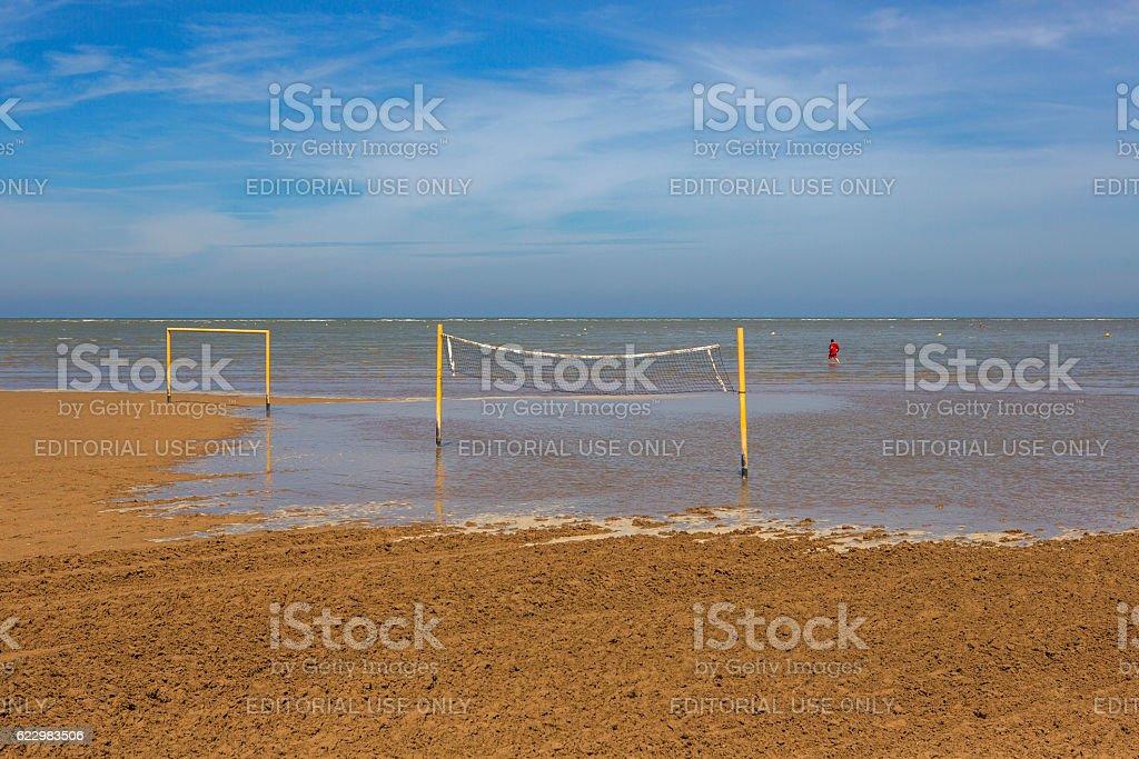 walking at sandy normandy coast during tide near calais france stock photo