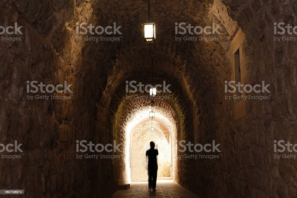 Walking Away from the Light royalty-free stock photo