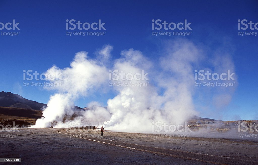 Walking between the geysers of El Tatio royalty-free stock photo