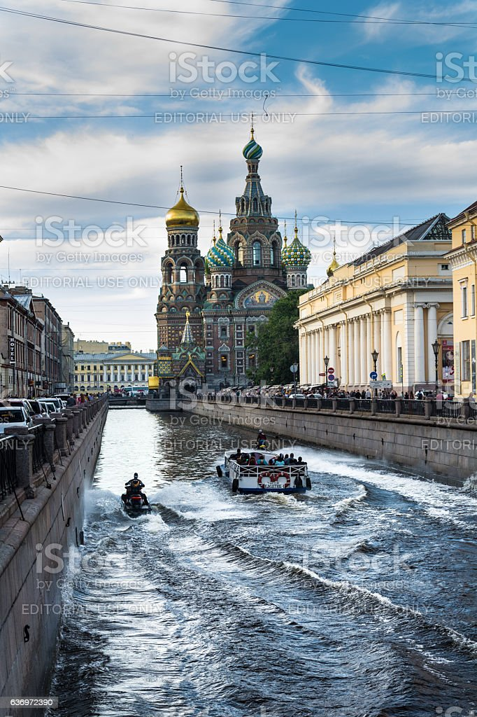 walking boat moves through the channel Griboyedov stock photo