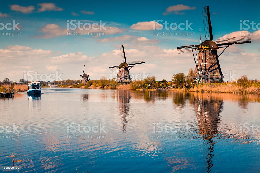 Walking boat on the famoust Kinderdijk canal with windmills. stock photo