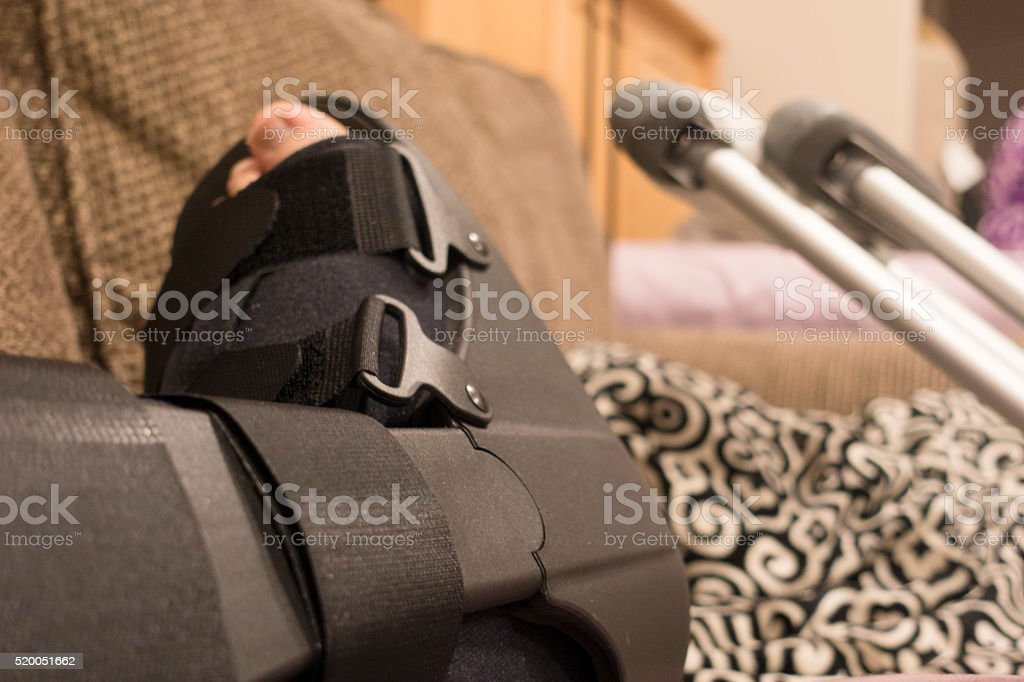 Walking Boot and Crutches - Broken Ankle, Fractured Foot, Sprained stock photo