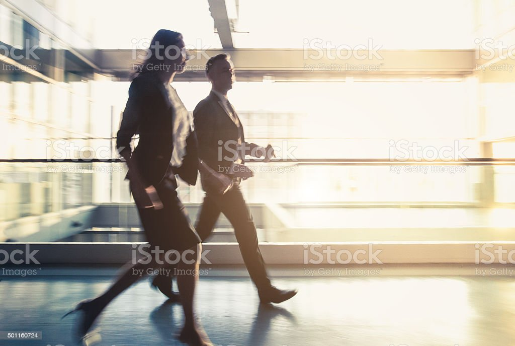 Walking business couple stock photo