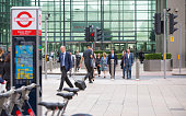 Walking business people in Canary Wharf, London