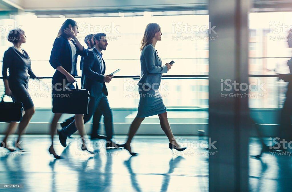 Walking business people stock photo