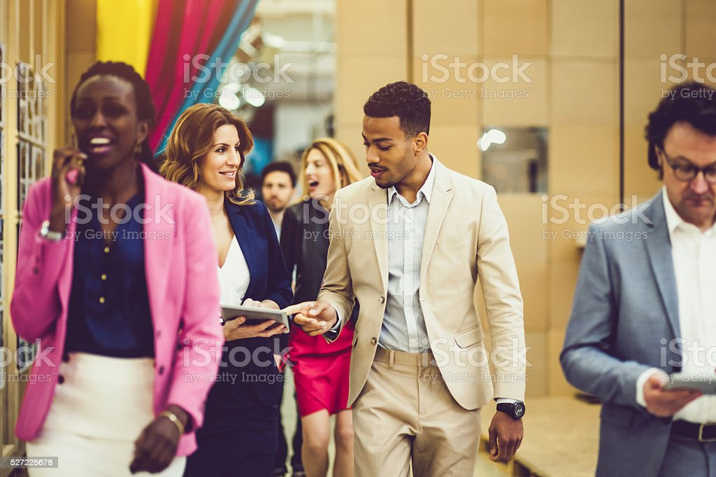 Walking business people stock photo