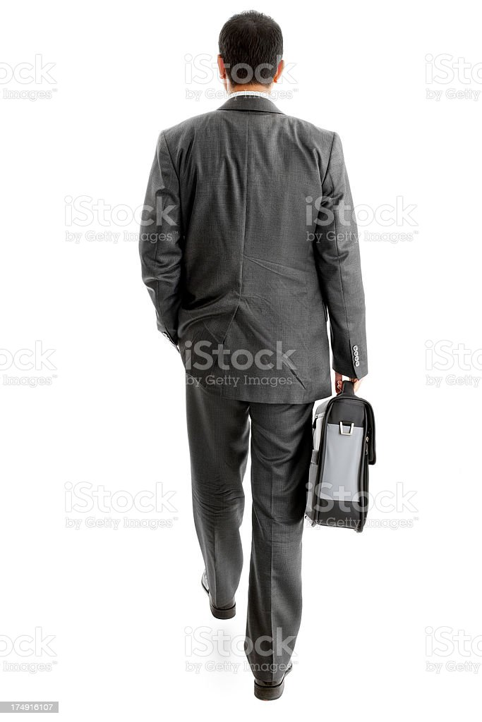 Walking Businessman holding a bag royalty-free stock photo
