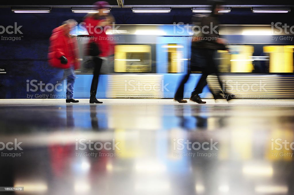 Walking commuters and motion blurred subway train royalty-free stock photo