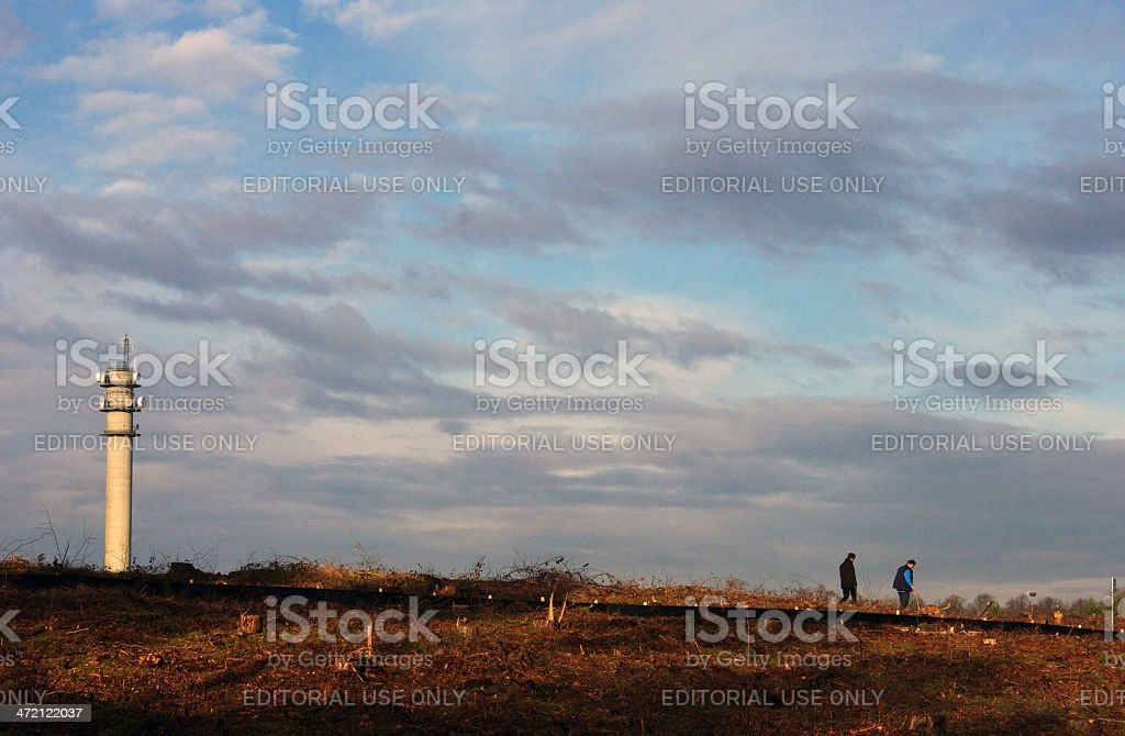 Walking couple in a moor area royalty-free stock photo