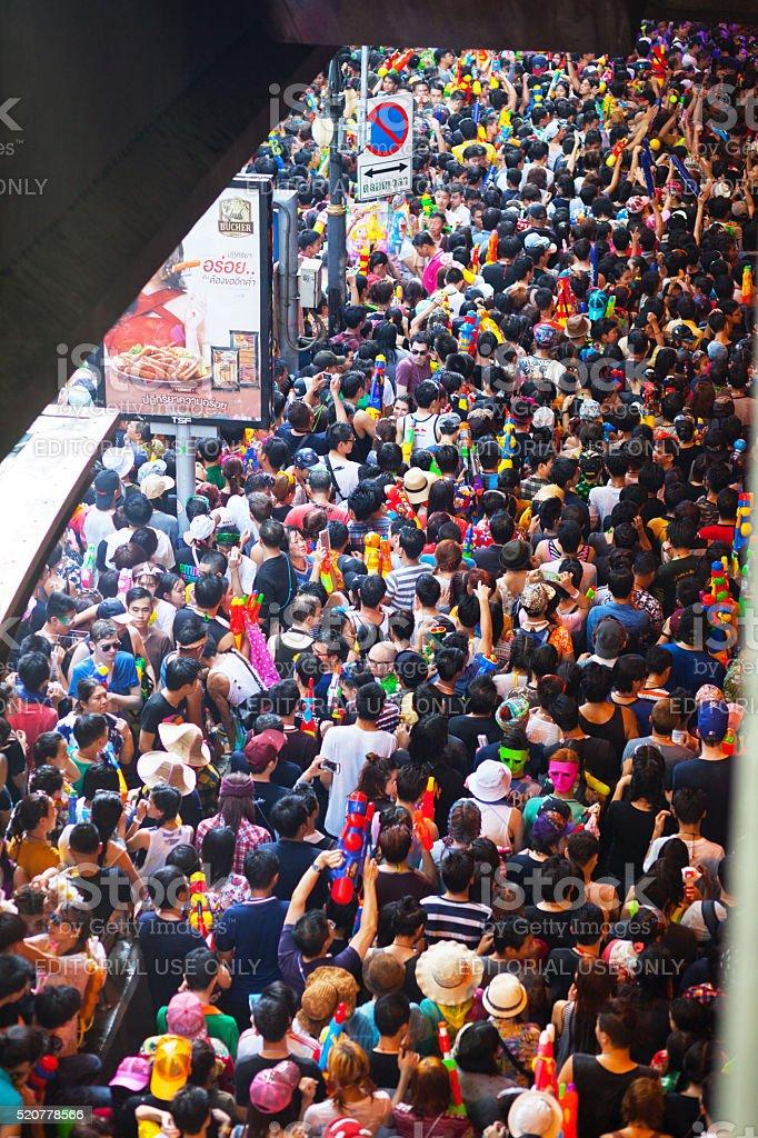 Walking crowd at Songkran in Silom Road stock photo