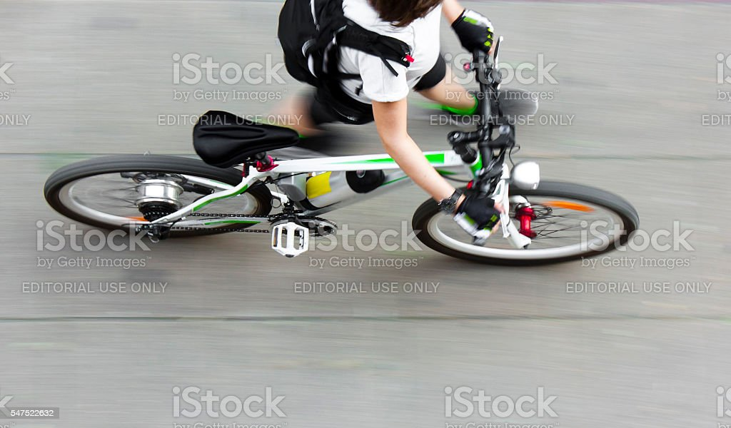 Walking cyclist stock photo