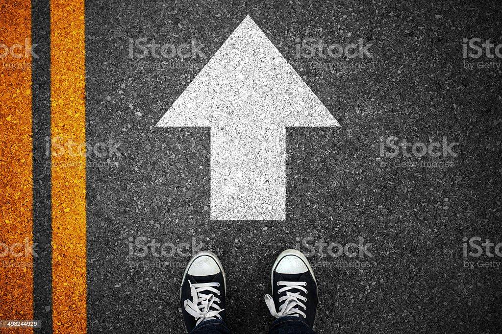 Walking direction on asphalt stock photo
